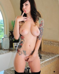 Ivy Snow jumps inside her marble bath and spreads her pussy with a huge purple dildo